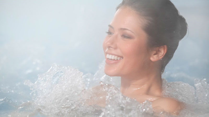 Female Enjoying Hot Tub Winter