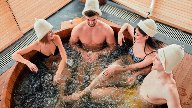 Couples Enjoying Hot Tub